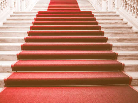 ceremonial: Red carpet on a stairway used to mark the route taken by heads of state, vips and celebrities on ceremonial and formal occasions or events vintage