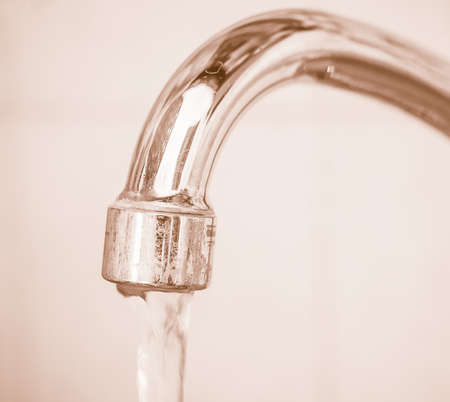 sink: Kitchen sink tap with flowing water vintage Stock Photo