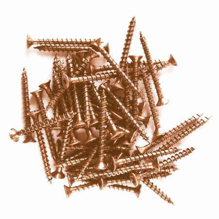 ferreteria: Detalle de tornillos de bronce para la madera trabaja vendimia Foto de archivo