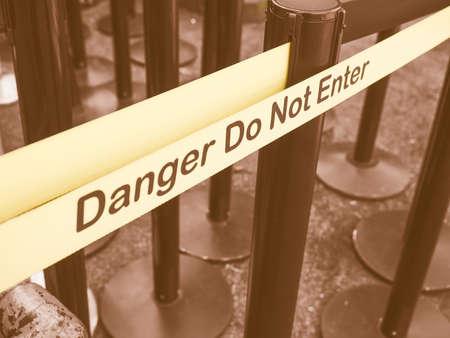 Yellow band fence danger do not enter warning sign vintage