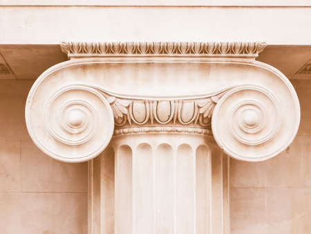 ionic: Architectural detail of an ancient Ionic capital vintage Stock Photo