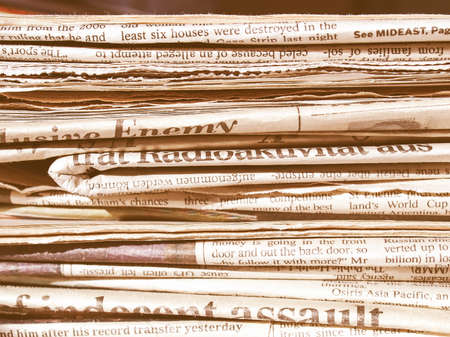 pile of newspapers: Detail of a pile of international newspapers vintage Stock Photo