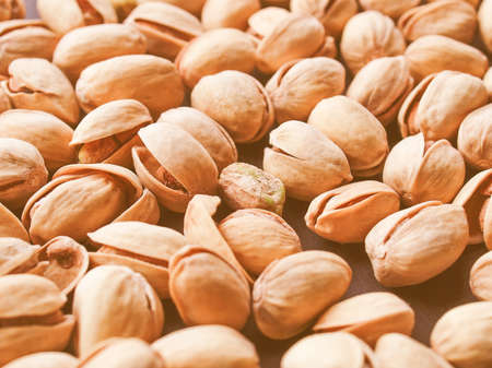 Vintage looking Food - Salted roasted pistachio nut with shell - useful as a background Stock Photo