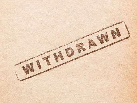 withdrawn: Withdrawn stamp on a book page vintage