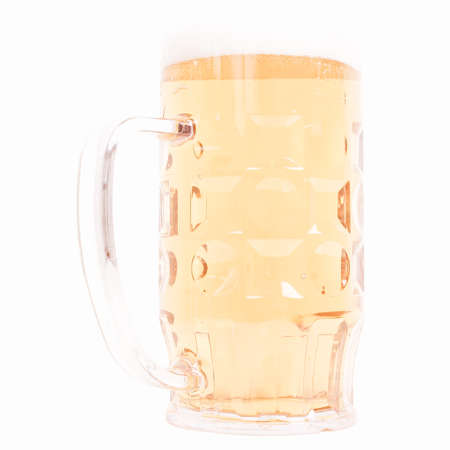 litre: Large German bierkrug beer mug tankard glass, half litre, one pint of Lager - isolated over white background vintage Stock Photo