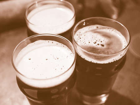 alcoholic: Three pints of beer alcoholic drink vintage