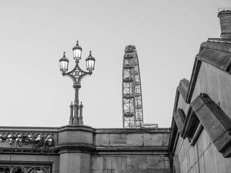 millennium wheel: LONDON, UK - JUNE 10, 2015: The London Eye ferris wheel on the South Bank of River Thames aka Millennium Wheel at night in black and white