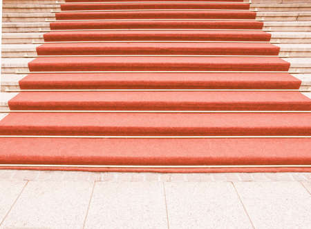 are taken: Red carpet on a stairway used to mark the route taken by heads of state, vips and celebrities on ceremonial and formal occasions or events vintage