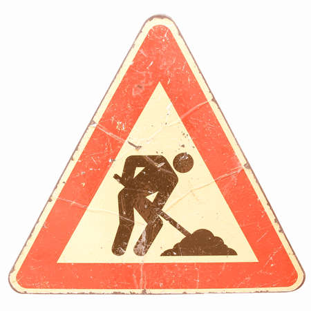 road works: Road works sign for construction works in progress - isolated over white background vintage Stock Photo