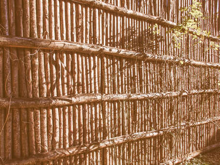 and the stakes: Medieval palisade stakewall fence wall made from wooden stakes or tree trunks used as a defensive structure vintage
