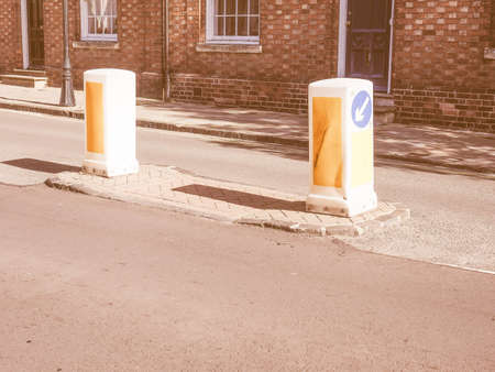 obstruct: Traffic bollard short vertical post to control or direct road traffic and obstruct the passage of motor vehicles vintage Stock Photo