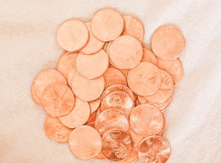 penny: Dollar coins 1 cent wheat penny cent currency of the United States  over burlap background vintage Stock Photo