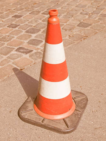 Traffic cone used in street road works vintage Stock Photo