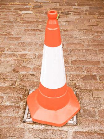 roadworks: Orange and white traffic cone for roadworks vintage Stock Photo