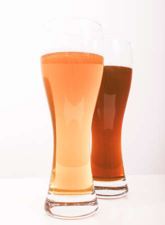 weiss: Two glasses of German dark and white weizen beer vintage