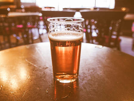 ale: A pint of English ale beer in a pub vintage