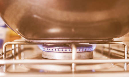 gas cooker: Saucepan on a gas cooker vintage