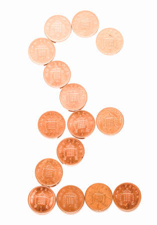 uk money: Pound currency sign made with One Penny coins vintage