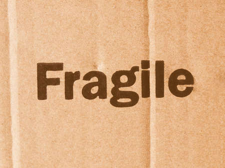handle with care: Fragile Handle with Care Do not drop label on a corrugated cardboard box vintage