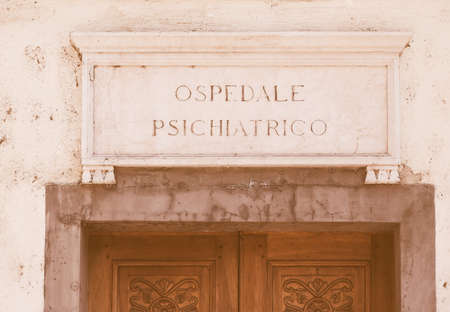 talian: Vintage looking Ospedale Psichiatrico ancient talian sign meaning Mental Hospital Stock Photo