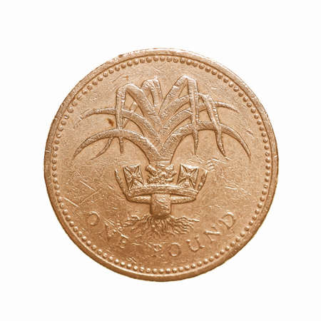 comp: Pound coin - 1 Pound currency of the United Kingdom isolated over white background vintage Stock Photo