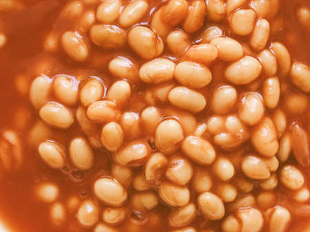 Hintergrund: Vintage looking Detail of baked beans in tomato sauce - useful as a background