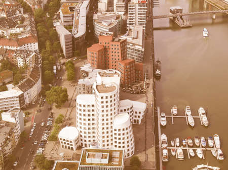 frank: DUESSELDORF, GERMANY - AUGUST 3, 2009: The new Medienafen is a redevelopment area in the former docklands and harbour with buildings designed by Steven Holl, David Chipperfield and Frank O Gehry vintage Editorial