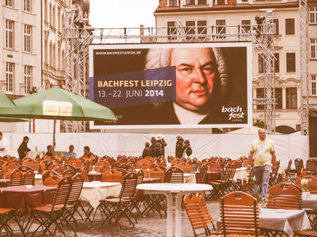 beer garden: LEIPZIG, GERMANY - JUNE 14, 2014: People in beer garden at the Bachfest annual summer music festival celebrating baroque musician Johann Sebastian Bach in his town vintage Editorial