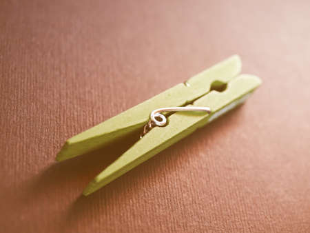 loaded: Clothespin or clothes peg spring loaded wood clamp vintage Stock Photo
