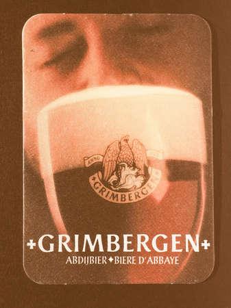belgie: BRUSSELS, BELGIUM - DECEMBER 11, 2014: Beermat of Belgian beer Grimbergen vintage Editorial