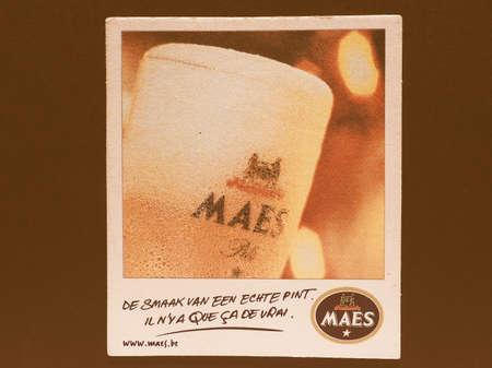 belgie: BRUSSELS, BELGIUM - DECEMBER 11, 2014: Beermat of Belgian beer Maes vintage