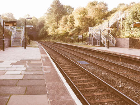 urban scene: Wood End railway station on the Stratford upon Avon to Birmingham route in Tanworth in Arden, UK vintage