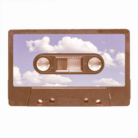 stereo cut: Magnetic tape cassette for audio music recording - blue sky with clouds label vintage