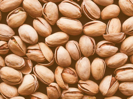 Hintergrund: Vintage looking Food - Salted roasted pistachio nut with shell - useful as a background Stock Photo