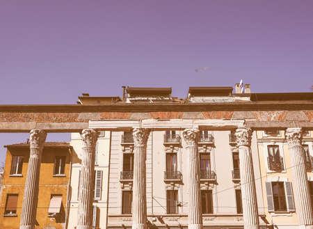 lorenzo: Vintage looking Colonne di San Lorenzo St Lawrence columns ancient Roman ruins Milan Italy Stock Photo