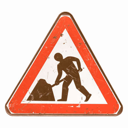 road works: Road works sign for construction works in street - isolated over white background vintage Stock Photo