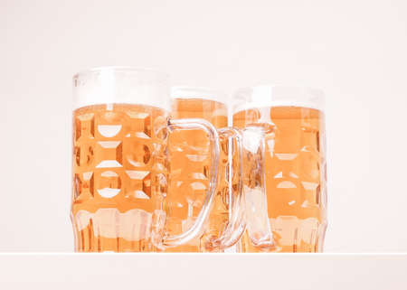 pilsner glass: Many large glasses of German lager beer vintage Stock Photo