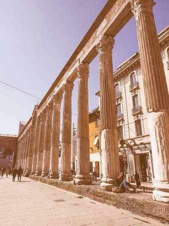 lawrence: MILAN, ITALY - MARCH 28, 2015: Colonne di San Lorenzo meaning St Lawrence columns, ancient Roman ruins Milan Italy vintage