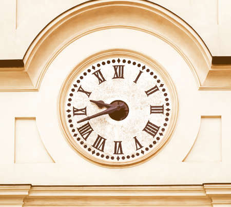 numerals: An old city clock with roman numerals vintage