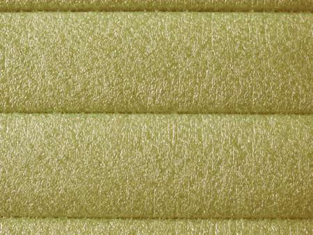 propylene: Green soft polypropylene pillow useful as a background vintage Stock Photo