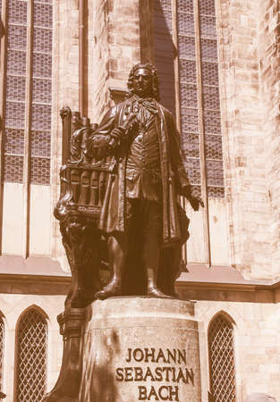st german: The Neues Bach Denkmal meaning new Bach monument stands since 1908 in front of the St Thomas Kirche church where Johann Sebastian Bach is buried in Leipzig Germany vintage Stock Photo