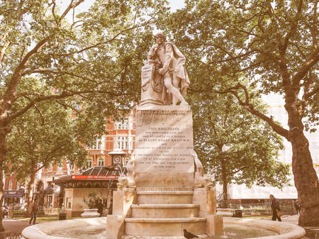 LONDON, UK - JUNE 10, 2015: Statue of William Shakespeare built in 1874 in Leicester Square vintage Editorial