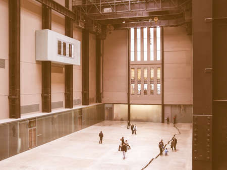 housed: LONDON, UK - CIRCA MARCH, 2008: The Turbine Hall which once housed the electricity generators of the power station is now a huge open public space part of Tate Modern art gallery in South Bank vintage