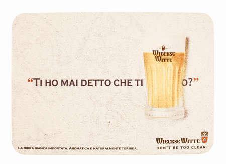 weiss: BRUSSELS, BELGIUM - MARCH 15, 2015: Beermat of Belgian weiss beer Wieckse Witte isolated over white background vintage