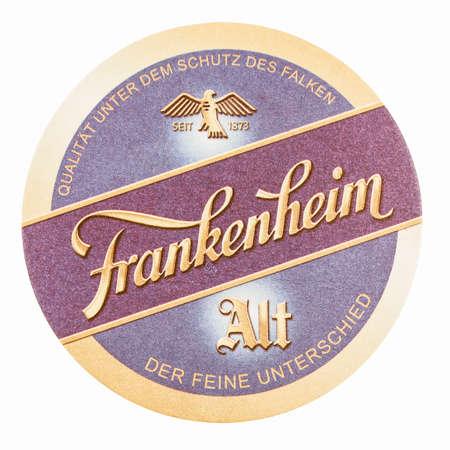 alt: BERLIN, GERMANY - MARCH 15, 2015: Beermat of German beer Frankenheim Alt isolated over white background vintage