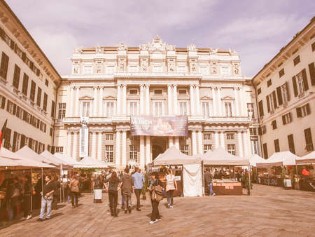 doge: GENOA, ITALY - MARCH 16, 2014: Tourists in front of Palazzo Ducale Doge Palace which is the main exhibition hall in town vintage Editorial