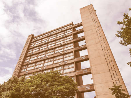 listed: LONDON, ENGLAND, UK - JUNE 20, 2011: The Balfron Tower designed by Erno Goldfinger in 1963 is a Grade II listed masterpiece of new brutalist architecture vintage