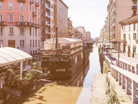 28: MILAN, ITALY - MARCH 28, 2015: Naviglio canal waterway in Milan Italy vintage Editorial
