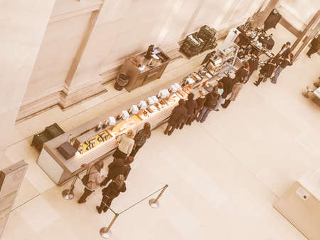 cafeteria tray: LONDON, UK - CIRCA MARCH, 2009: People queueing at the British Museum cafeteria bar in the Great Court vintage