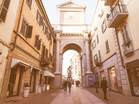 city centre: CHIERI, ITALY - JANUARY 12, 2015: Tourists visiting Via Vittorio Emanuele high street in the city centre vintage Editorial